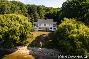Rare find and opportunity.  1900's estate home with 120' frontage on Lake Macatawa.  1.32 acre parcel to build your dream or take on an incredible restoration.  Enter the property through a winding wooded drive.  Then exit the shade and privacy of the drive to reveal sunlit home facing SW on the big bay portion of the lake.   Six bedrooms, two of which each have their own screened in porch.  A large screen porch on the main allows freshening breezes to be enjoyed.  Selling 'As Is' by the estate. Offers considered through Sunday, Sept 12 (6:00 PM).  Submit Highest & Best Offer. Estate to review offers Monday, Sept 13.  Deadline for Seller Acceptance must be at least Sept 15 (5:00 PM).   Accepted offer subject to approval of Probate Court.
