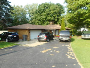 What a nice brick ranch in the Kenowa Hills School District in Walker. This solid home is great not only for comfortable living, but also for entertaining. Walk out the slider to  a covered patio leading to a very nice inground pool for your enjoyment. Imagine the hot summer days just stepping out your door to hours of relaxing, enjoyment, and exercising in your pool. Nice!!!  This home is good sized with over 1,500 square feet. Plus, look at the lot. Overall it is 336x250 irr. with some trees, and some extra parking spaces for family and guests. Need appliances? The kitchen appliances, plus the washer, dryer, and riding mower are included. What more could you need?