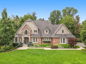 Premium Location. Stunning Architecture. Exceptional Quality & Craftsmanship. This custom-built home is tucked away on a quiet cul-de-sac in the sought-after Manchester Hills community (Forest Hills Central Schools!).The gorgeous gourmet kitchen with large center island flows into the light-filled family room with fireplace. An expansive mudroom area sits just behind the kitchen complete with built-in custom desk and lockers, laundry room, and entry to the oversized 3-car garage. The main floor master suite is elegant & classy, with french-doors leading to the backyard and deck. The upper-level features 3 bedrooms, 2 full bathrooms, and a huge bonus room. The basement was professionally built-out in 2014 (Bruce Heys Builders) complete with fireplace, wet bar, & radiant heat flooring. A guest bedroom, magnificent full bathroom, workout space, and flex room complete the basement.