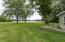 side lawn to lake 90' frontage.