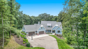 Now is your chance to own one of Rockford's finest custom built Engelsma homes in the desirable River Bluffs community. Home was featured in the 2017 ''parade of homes'' which sits on 2 acres of peaceful scenery and approx. 200+ ft. of Rogue River Frontage. This home is a Show Stopper! Brand new epoxy flooring in the 4 car garage. Bonus room above, ready to be finished. Boasting high ceilings, open concept floor plan with one of the biggest kitchen islands you will ever see! Dual shower heads in the main bathroom, walk-in closet galore! Office with a closet!? Turn it into a 5th bedroom!? Walk downstairs into the custom built movie theater room that is made to feel, smell and look like an actual theater ! Play with the kids in the oversized house or use it for the fur babies! A Must See!