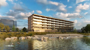 Waterfront view shows expansive terraces and wrap around windows on corner units.