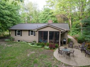 Rare opportunity to own a very profitable cottage rental on Lakeshore Drive as well as a beautiful 80 ft buildable lot on Lake Michigan. The cottage (4183 Lakeshore) has 3 bedrooms, 2.5 bathrooms and 2200 sq ft of living space. The kitchen has ample counter space and storage. The lower level is finished providing additional entertaining space. There is a screened in porch to enjoy the summer breeze. The buildable lot (4187 Lakeshore) is your opportunity to build a home of your dreams. A steel seawall has been built to protect your dune and future home.