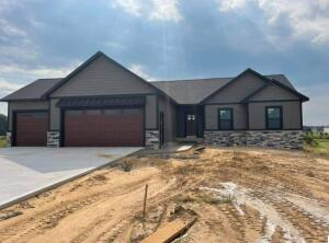Brand New Construction in Traders View!! 1641 sq foot ranch with 3 bedrooms and 2.5 bathrooms on the main floor. Custom features throughout! All of this sitting on 1.2 acres. Traders View amenities include common area down by the Grand River! Don't miss out on this opportunity!Estimated completion date Sept. 15, 2021.
