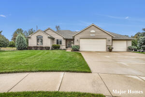 Take a look at this sprawling Ranch on a 1/2 acre lot in a cul-de-sac that backs up to the Kent trails! This spacious home has almost 2,000 sq ft on the main floor featuring 4 bedrooms (could easily be 5) & 3.5 bathrooms. As you enter the foyer you are greeted by the cathedral ceilings & gas fireplace in the living room w/ windows facing west for the afternoon sunsets. The master ensuite has a soaking tub, walk-in shower & closet. Enjoy the granite counters in the kitchen, new farmhouse sink, formal dining room & main floor laundry. The large deck off the dining room views your fenced-in yard & shed w/ a built-in playhouse! Bonus: New Roof (2015) w/ transferable warranty, 2 water heaters (2017 & 2018), New carpet & kitchen floors, & the garage is heated too! Book your showing today!