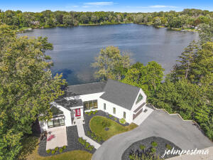FISK LAKE: Welcome home to your new private resort. Located in the heart of East Grand Rapids & a close walk to Gas Light Village. Panoramic views of the private all sports Fisk Lake with 141 feet of frontage. Built by Joel Peterson Homes in 2018. Open floor plan concept with Chefs Kitchen with fabulous floor to ceiling windows. Separate Primary Suite and private office. The home lives a contemporary lifestyle. Upstairs bonus room can be used for multipurpose. Lower-Level Walkout includes 3 bedrooms, family room, and 2 full baths. Pella Windows. Fenced in yard. Large Private Dock. Sale includes the vacant lot next door (1841 Wealthy St; PPN:41-14-33-126-003; Combined Assessed Value) Seller directs Listing Agent to hold all offers until Thursday, September 16th at 4pm