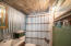 Main Floor Bath with walk in shower - wood plank ceiling