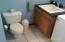 1/2 bath. / Laundry room, Basement area