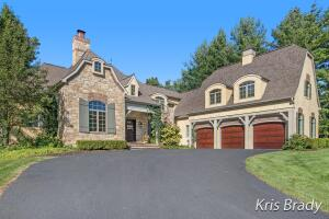"""Beautiful ''Manchester Hills'' estate home situated perfectly on approximately1.3 acres in one of Cascade's most sought after developments & in Forest Hillsschool district. This 4-bedroom 