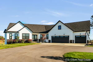 Incredible location!  Built in 2018, like new, 4200 square ft ranch on 4.3 acres that will surely impress.  Nearly 2000 sq ft on the main floor with an open concept that features a large kitchen with a ''super sized'' island, a x-large walk in pantry, a large living room with gas log fireplace, a sitting room with large picture windows that allow you to appreciate the setting, a screened in back porch, a large master suite and more.  The lower level offers two more bedrooms, and a large bar area.  The bonus room above the garage offers great flexibility......it could be a 5th bedroom, a home office, an excercise room or a number of other things.  All this perched on top of one of Ottawa County's highest spots that offers miles and miles of breathtaking views in multiple directions. Need space for an outbuilding, you've got it.  Build almost any size barn you'd like here.  Hot tub will remain with the home.  Schedule your showing today, you won't be disappointed!