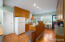 The beautiful hardwood flooring continues through the kitchen