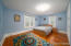 Large second floor secondary bedroom with stunning hardwoods!