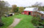 Back yard, garage and barn