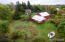 """Aerial view shows home, yard, barn and in the foreground is a small """"observatory"""" complete with telescope!"""