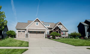 Lakefront living in beautiful Hudsonville, MI. Situated on a 37-acre all-sports lake this house is on a cul-de-sac teeming with kids. All of that makes this an ideal place to raise an active family.