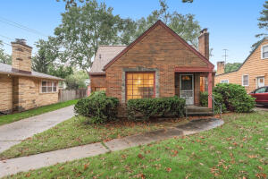 Adorable Alger Heights brick bungalow. Great character with arched doorways and hardwood flooring. Main level features 2 bedrooms and full bath. Cozy up to the living room fireplace with a good book or host a dinner in the dining room with huge window. Generous sized dormer with walk-in closet and storage space on upper level. Underground sprinkling installed. The partially fenced rear yard is the ideal space for a BBQ. Unfinished lower level can be additional storage or rec room. Newer roof. Just a short walk or drive to the library and the heart of Alger Heights featuring shopping and dining. Seller has directed Listing Agent/Broker to hold all offers until 12pm on 10/19.