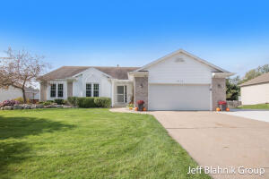 New Listing! Don't miss this 4 bed 3 bath brick ranch with 2 stall attached garage on a quiet street in Kenowa Schools in Walker. Quick drive to downtown or GVSU! You will love the open living/dining/ kitchen with wide plank flooring, cathedral ceilings, gas log fireplace, ceramic backsplash, large pantry and solid surface countertops with access to the large back deck overlooking the fenced in backyard with fire pit and above ground pool. The main floor also has 3 bedrooms and 2 full baths, including a large master suite with deep walk-in closet, and main level laundry in a closet in the hallway. The daylight lower level is mostly finished with a huge family room, 4th bedroom, and a utility room with lots of room for storage. Offers due via email Tuesday, Oct 19th at 10 a.m. See it today!