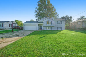 Welcome to 6442 College Ave! This beautiful four bedroom two full bathroom home has so much to offer. This home is set on a nearly half acre lot, has an attached 2-stall garage with an additional 2-stall outbuilding that has electric! This 1993 build boasts a newer roof(2019), central air, gas fireplace and all the appliances are included. Enjoy your spacious and fully fenced yard from your back deck located in a quiet neighbor in  the award winning Kentwood school district. Tons of storage, off-street parking, and close to many amenities this property will not last long. Schedule your showing today!