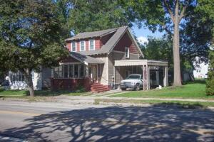 This house is located in one of the hottest areas in Grand Rapids! A perfect location for commuting to work, enjoying Riverside Park and all the fun downtown has to offer. This 2 bedroom 1 1/2 bath is waiting for someone to make it a home. Enter the front door to  a large all seasons room, or from the side of the house under the protection of a large carport, or from the backdoor into the spacious eat in kitchen. An alley way in the back of the house allows easy access to and from the garage and large fenced yard. This house has serious potential!!