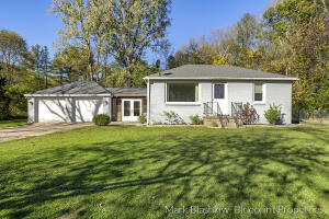***Multiple offers received*** Highest and best due by 10AM on Thursday, October 21th. Big things come in small packages!  This 2-bedroom 1 bath ranch in Ada Township falls within Northview School District and sits on 1 acre.  Knapp's Corner - arguably one of the best shopping/dining/entertainment districts in all of Grand Rapids, is less than a 5-minute drive.  The kitchen has a brand-new granite countertop and tile backsplash.  The bathroom is completely updated and will not disappoint!  There is a mudroom off the 2-stall garage that leads into the kitchen.  Nice living room and 2 bedrooms complete the main floor.  Downstairs has a large recreation room on one side, with storage/mechanical/laundry room on the other side. 2020 roof and replacement windows.  The home sits far enough back that Grand River traffic is not an issue.  Survey on file. Grand River is a beautiful street year-round, especially in the fall.
