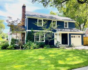 Classic two story home in the highly regarded Ottawa Hills. This home is located only steps away from the Grand Rapids Christian Elementary school. Walking distance to East Town or Gaslight Village! Inside, you will be pleased to find a warm and inviting home that has been substantially renovated! New roof and gutters installed March 2020. The main floor presents a living room with wood burning gas fireplace, dining room, both with polished hardwood floors and an updated kitchen / breakfast area with a newly added walkout deck to the beautiful private backyard. Upstairs you will find more polished hardwoods, a large master bedroom with a wall of custom built-in wardrobe cabinets, two additional, enormous bedrooms and a remodeled full bathroom. Half of the basement has been finished, creati Classic two story home in the highly regarded Ottawa Hills Neighborhood Association. This home is located only steps away from the Grand Rapids Christian Elementary school. Walking distance to East Town or Gaslight Village! Inside, you will be pleased to find a warm and inviting home that has been substantially renovated! New roof and gutters installed March 2020. The main floor presents a living room with wood burning gas fireplace, dining room, both with polished hardwood floors and an updated kitchen / breakfast area with a newly added walkout deck to the beautiful private backyard. Upstairs you will find more polished hardwoods, a large master bedroom with a wall of custom built-in wardrobe cabinets, two additional, enormous bedrooms and a remodeled full bathroom. Half of the basement has been finished, creating a cozy family room with a fireplace. The other half offers a space for laundry and plenty of storage. Entire inside and outside of the home freshly painted in the Fall 2019. Located on a large corner lot, very rare to find in the city. Plenty of space to enjoy the outdoors.