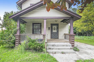 3 bedroom, 2 bath house with great covered front porch.  Beautiful newer flooring in bedrooms, plus kitchen has been updated!  Spacious deck on back of house overlooking the  back yard!