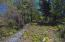 This property has a head start with a rock wall separating the lot. What you do from there is all up to you...