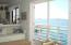 Penthouse open floor plan living space with private porch