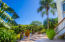 Grounds at Villa Delfin - lush gardens surround the path way to the pool