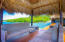 Two semi private palapas offer shaded seating areas and lounge areas under the sun.