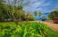 Lush tropical gardens surround the property