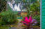 Lush tropical gardens surround the property