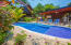 Enjoy the common area pool and BBQ area steps away from your dooe