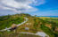 Lot 141 is has road frontage access as well as uninterrupted views of the Caribbean Sea.