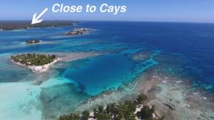 Reef Point Near Utila Cays L16, Sandy Beach Dock Slip Dream, Utila,