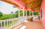 Lush tropical views from the main house balcony, located on the upper level