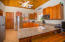 Spacious full kitchen in the main house, include granite countertops and stainless steal appliances.