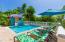 Enjoy lush tropical garden that surround the pool area