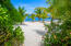 The pristine uncluttered sand beach of Coral Views.