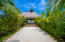 Lush manicured tropical gardens surround the common areas