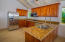 Spacious kitchen with custom cabinets and stainless steal appliances