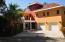 Dos Pelicanos has a 2 car garage and parking area.