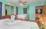 Bedroom area has 2 queen beds in unit #23