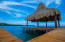 The palapa on the dock in Coral Views is a tranquil area perfect for yoga or lounging