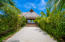 Lush tropical gardens surround the common areas and the path to the common area pool and beach