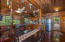 This rustic island kitchen and dining area creates and island atmosphere