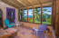 This fully screened in porch offers an additional living space