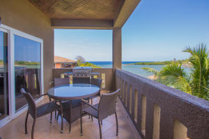 This large terrace offers cooling breezes and ocean views of Mangrove Bight