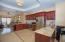 High end kitchen with granite counter tops and mahogany cabinets
