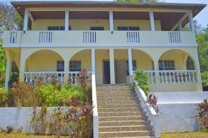 standing home & 2 Apartments, 0.466 Acre with 2 story single, Roatan,